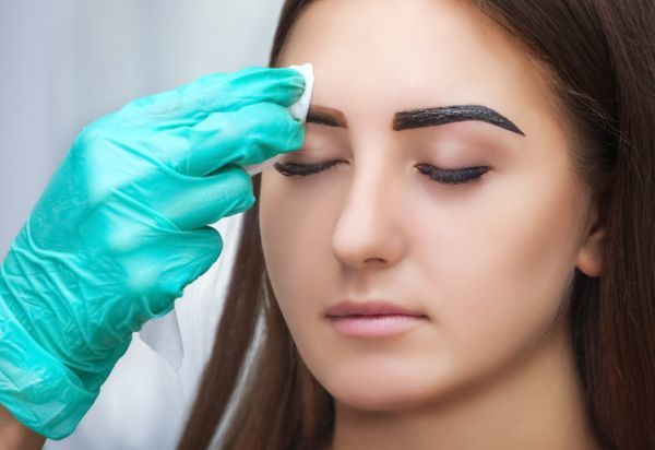 Cleaning eyebrow with henna